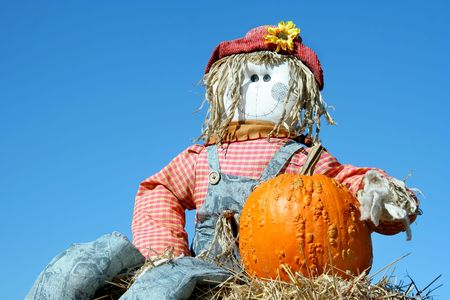 Blue sky background and homemade scarecrow photo