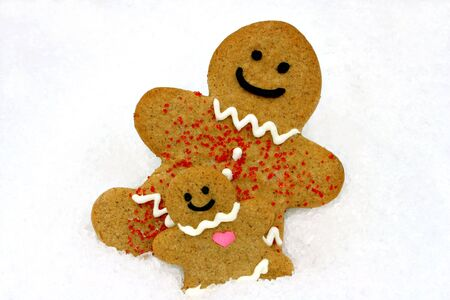gingerbreadman: Mom and baby gingerbread cookie in the snow. Stock Photo
