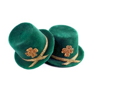 Two St. Patricks Day top hats isolated on white with copy space. photo