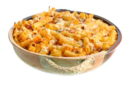 One full pan of homemade baked ziti on a white background. Stock Photo