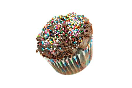One chocolate cupcake with sprinkles, isolated on white with copy space.   Cupcake on slant and appears mid-air. Stock Photo - 4392398