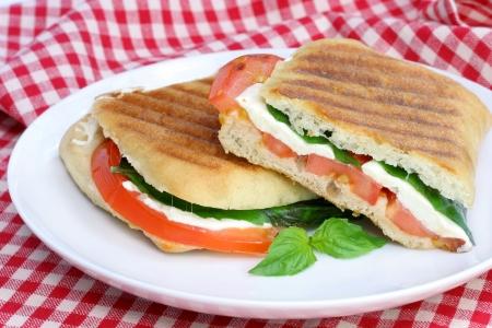 Tomato, basil, and fresh mozzarella grilled panini sandwich.