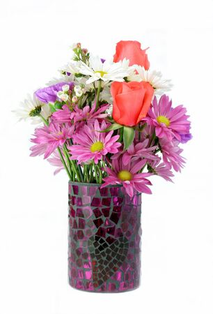 Beautiful assorted flowers in a vase isolated on white with copy space. photo