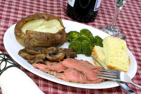 broil: London broil steak, baked potato, semolina bread, mushrooms and broccoli cooked to perfection.