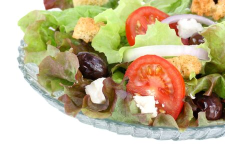 croutons: Fresh Greek salad with calamata olives, feta cheese, tomatoes, onions, croutons and crisp greens.