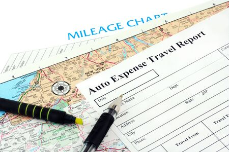 A mileage report on top of a map and mileage chart with highlighter and pen.