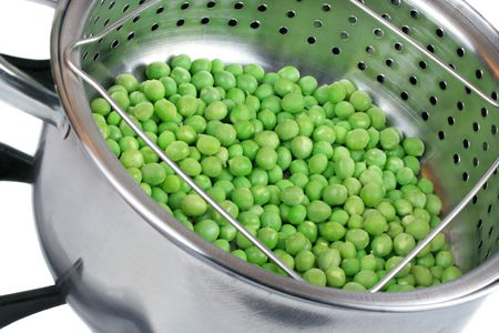Fresh peas in a steamer pan