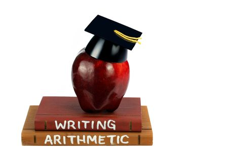 Two textbooks with an apple with a graduation cap on top, isolated on white with copy space. photo