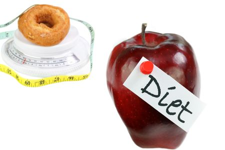 An apple with the message Diet on it in front of a doughnut on a scale with a tape measure around it.  Tape measure front number is 48 to indicate results of eating donuts rather than diet. photo