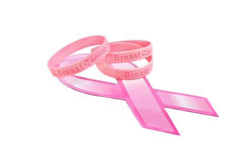 Three cancer awareness rubber bracelets on a pink ribbon. Isolated on white with copy space. Foto de archivo