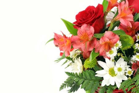 Roses, daisies and lilies make up a bouquet entering the right side of the image.  Isolated on white with copy space. Foto de archivo