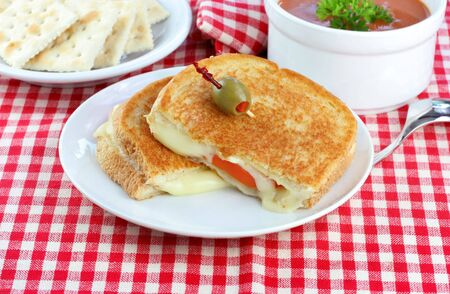 Grilled Cheese and Tomato,  Tomato Soup and a side of crackers for a delicious, healthy lunch or dinner. Stock Photo - 5292371
