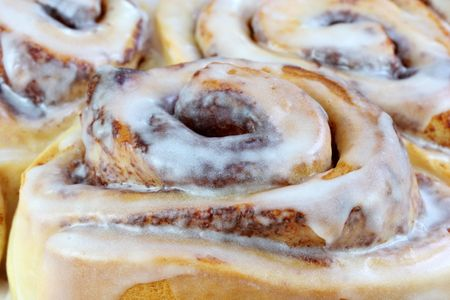 Cinnamon buns in an extreme macro close up using selective focus on foreground bun.