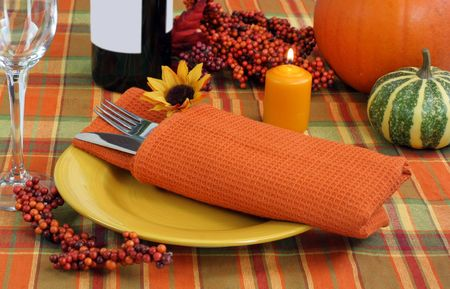 holiday meal: Table setting with autumn evening ambience for the Thanksgiving holiday meal. Stock Photo