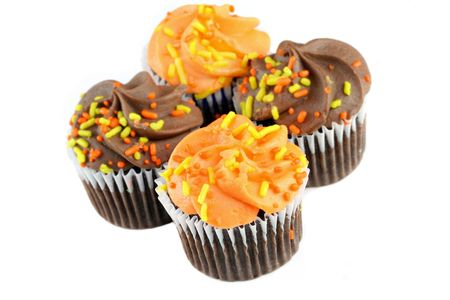Choclate cupcakes decorated for fall on white with copy space. Stock Photo - 5785061