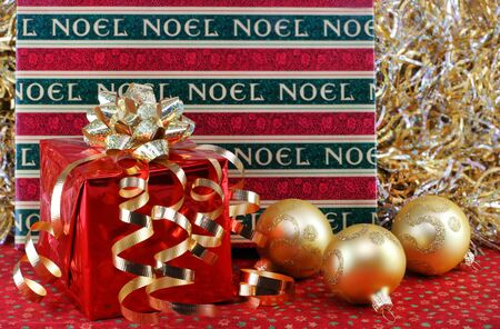 wrapped up: Two beautiful Christmas gifts with shiny ribbons, bows and ornaments.