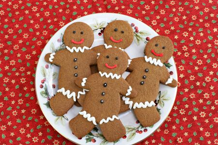 Gingerbread man cookies on a Christmas plate. photo