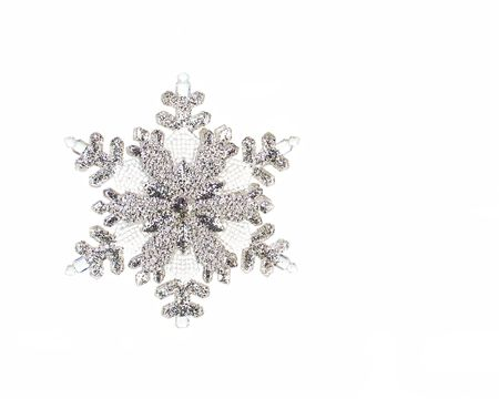 One glittering silver snowflake isolated on white with copy space.