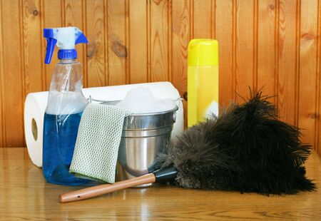 duster: Spring cleaning supplies, including a bucket with suds, ostrich feather duster and window cleaner. Stock Photo