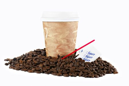 Coffee to go cup, with lid, in coffee beans on a white background with copy space.  Stirers and sugar included.