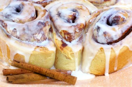 Close up of three fresh out of the oven cinnamon buns. photo