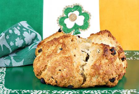 Fresh baked loaf of Irish Soda Bread surrounded by Irish decor.
