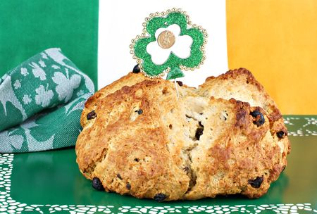 Fresh baked loaf of Irish Soda Bread surrounded by Irish decor.