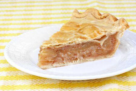 One freshly baked slice of apple cinnamon pie. photo