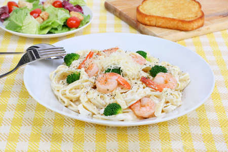 Freshly made shrimp fettucini in Alfredo sauce. Stock Photo - 6498843