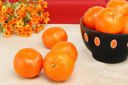 Healthy, organic clementines or tangerines in a bowl and on a table. Stock Photo - 6525438