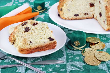 bread soda: Fresh baked Irish Soda Bread on a festive table with golden coins and tophats. Stock Photo