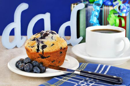 One blueberry muffin, gifts, coffee and the letters dad for fathers special day. Stock Photo