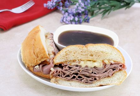 Delicious roast beef dip sandwich with onions, melted cheese and plenty of dipping sauce. Stock Photo - 6653770