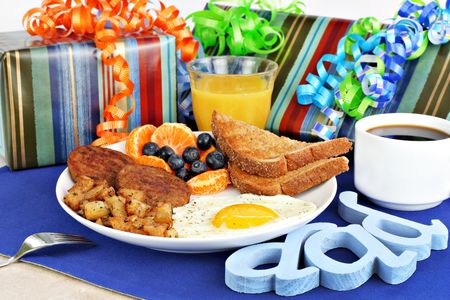 Delicious egg, toast, sausage, homefries, fruit and coffee breakfast for dads special day including gifts.
