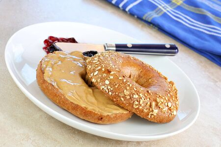 bagel: Healthy oat bran bagel spread with creamy peanut butter.