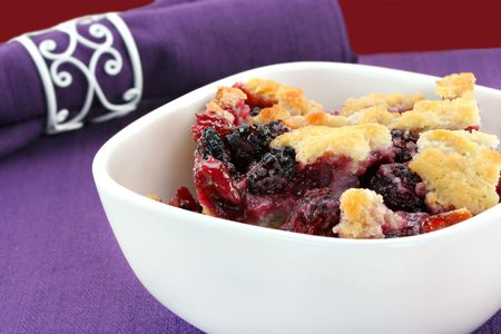 berry: Berry cobbler, freshly made, in a white bowl.