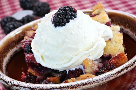 Fresh and delicious blackberry cobbler with French vanilla ice cream. Stock Photo