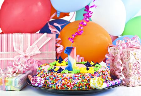 children party: Pretty pink birthday cake with the number 1 candle.