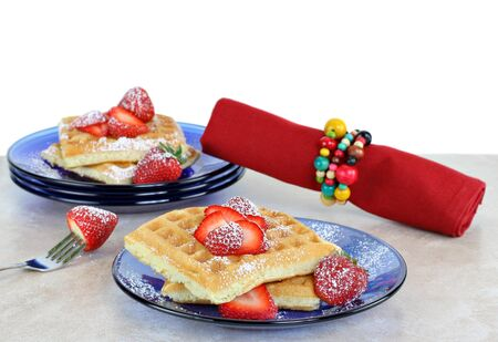 Healthy homemade waffles with fresh sliced strawberries.  White background for copy space. Stock Photo - 7195999