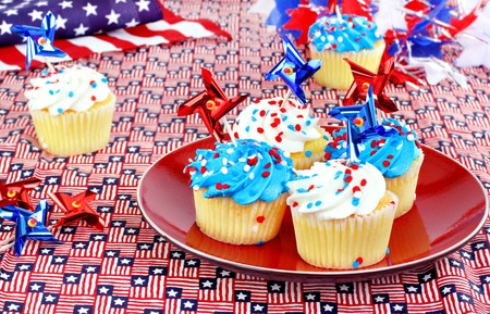 July 4th cupcakes in a festive celebratory table setting. photo