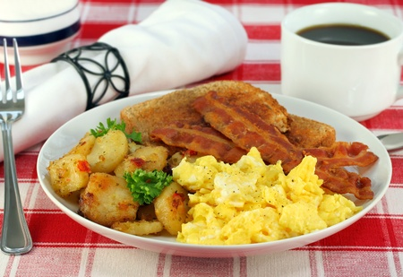scrambled: Eggs, home fries, bacon and toast for breakfast.