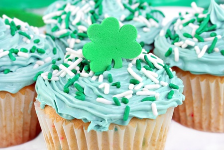 Festive cupcakes decorated with a shamrock for St. Patricks Day.  photo