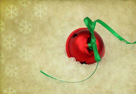 Red Christmas Sleigh Bell on a vintage background with snowflakes. photo