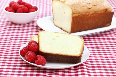 Healthy raspberries with a freshly baked pound cake. Stock fotó - 9945076