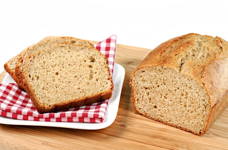 One sliced loaf of fresh baked healthy banana bread.  Copy space available. photo