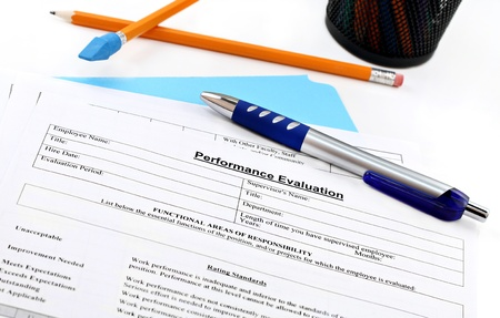 expectations: Blank performance evaluation with pen.  Selective focus on heading. Stock Photo