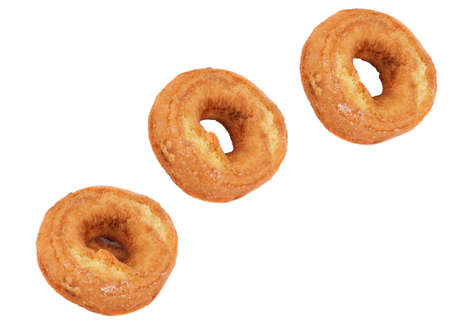 appear: Three doughnuts which appear to be flying thru the air.  White background and copy space. Stock Photo