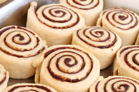 A pan of raw, homemade cinnamon buns in a pan ready to bake.  Selective focus. Stock Photo - 12982878