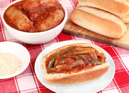 Italian sausage,pepper and onions with tomato sauce   Buns and shredded cheese to the side  Stok Fotoğraf