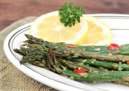 Fresh roasted asparagus with garlic and roasted red pepper.  Macro with selective focus.